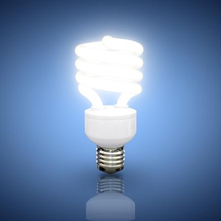 energy conservation: Energy saving fluorescent lightbulb on blue background