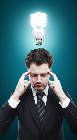businessman thinking and energy saving lamp Stock Photo - 17641247