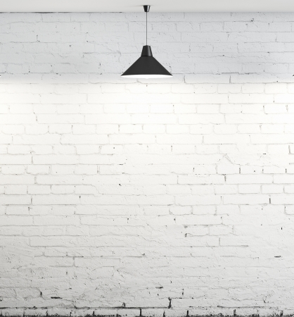 the white wall: brick wall and ceiling lamp