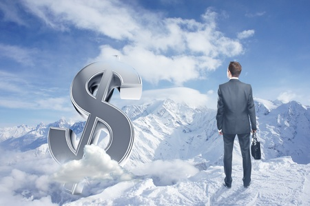 businessman with brifcase looking to dollar symbol and winter mountains photo