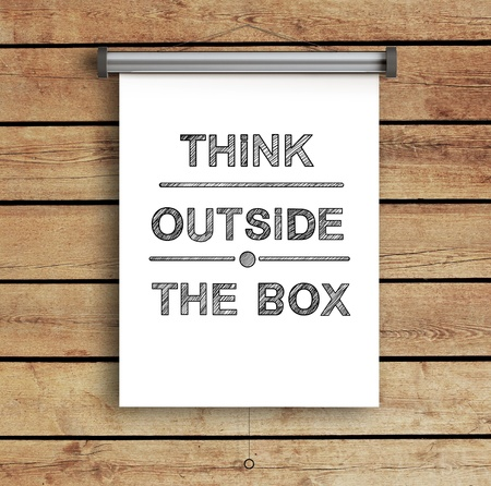 placard think outside the box on wooden wall photo