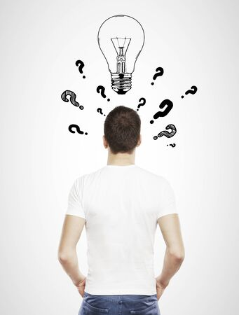 adult young: guy in T-shirt with question mark and lamp