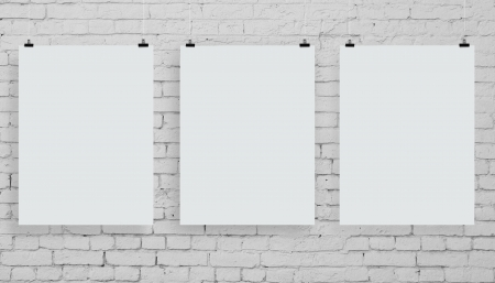 gallery wall: brick wall with three white poster