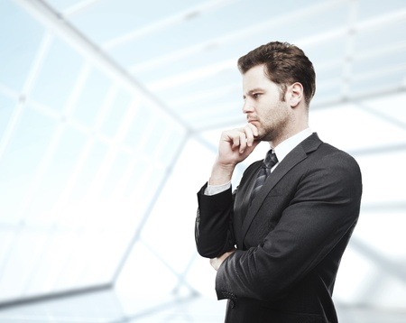 businessman thinking in white loft office Stock Photo - 17792927