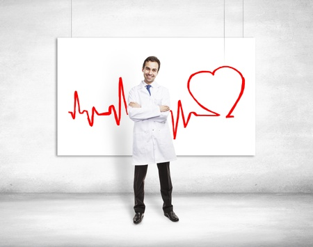 heart doctor: happy doctor and cardiogram on poster