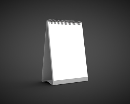 blank calendar on a black background photo