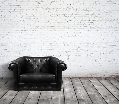 cement wall: leather sofa in brick room