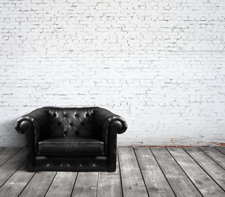 old sofa: leather sofa in brick room