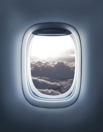 airplane window: clouds in the aircrafts porthole