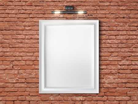 frame on red brick wall with wall lamp photo