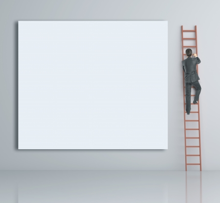 man climbing on ladder and blank poster photo