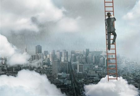 man climbing on ladder, urban business concept photo