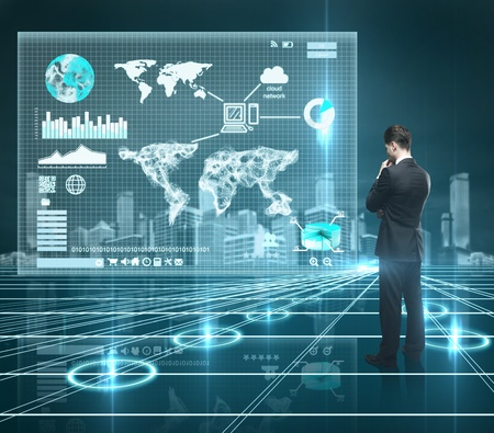 businessman looking world map on interface screen photo