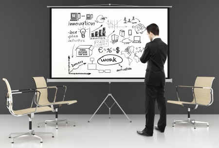 man looking at business strategy on ecran Stock Photo