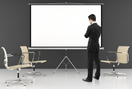businessman looking at  on blank ecran