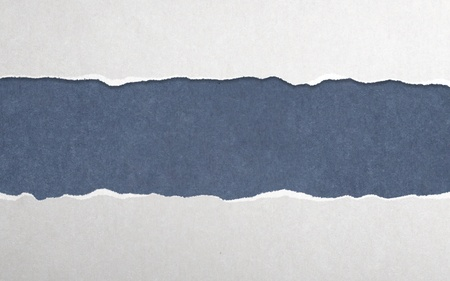 Torn paper with blue background Stock Photo - 18039243