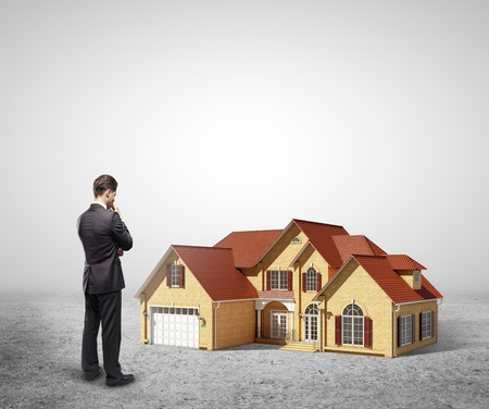 businessman looking at model house Stock Photo - 18039710
