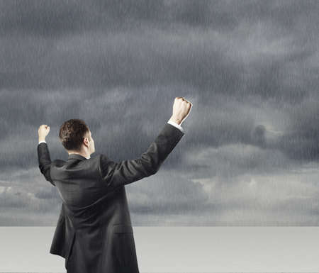 happy young businessman and thunderstorm Stock Photo - 18039728