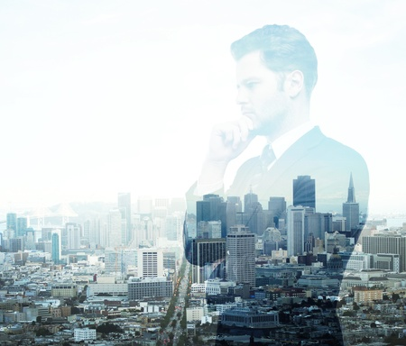 Businessman standing on background of city Stock Photo - 18039726
