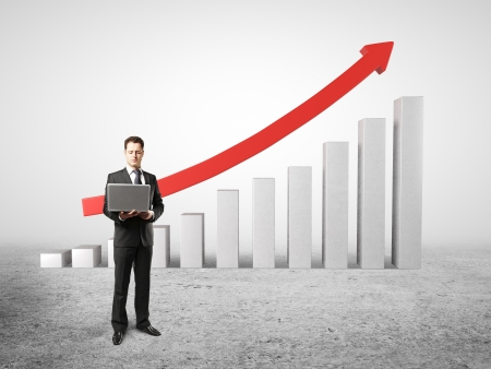 man holding laptop near of chart profits Stock Photo - 18039724