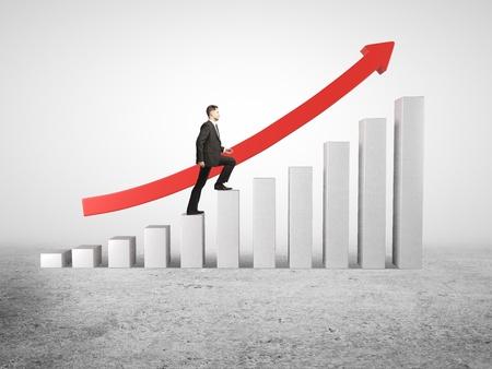 businessman rises up on business diagram Stock Photo - 18039725