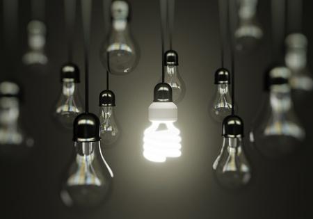 energy conservation: lightbulbs on gray background, idea concept