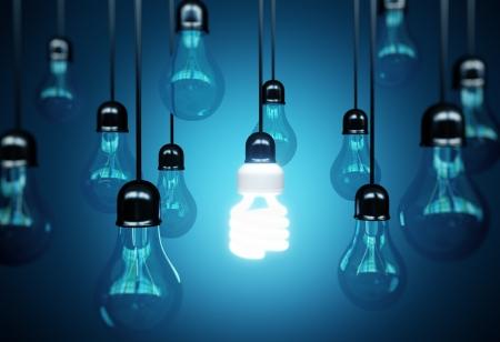 eficiencia energetica: bombillas sobre fondo azul, concepto idea Foto de archivo