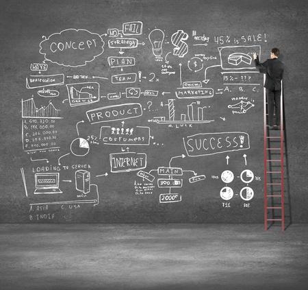 man climbing on ladder drawing business plan Stock Photo - 18039752