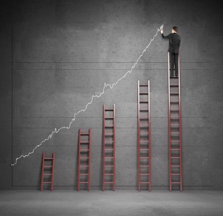 reaching up: man climbing on ladder drawing graphic
