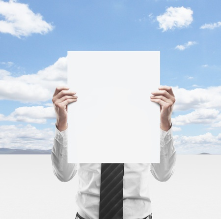 businessman holding  placard on background of sky Stock Photo - 18039643