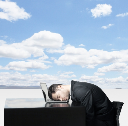 Businessman sleep at laptop on background of nature photo