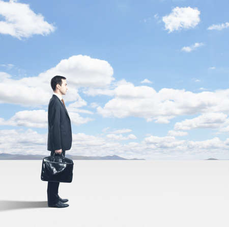 man with briefcase standing and blue sky Stock Photo - 18039646
