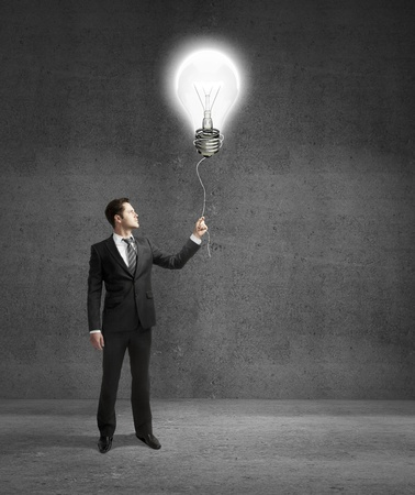 businessman standing on concrete room with drawing lamp Stock Photo - 18039757