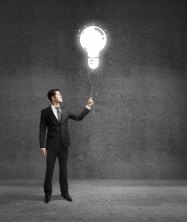 businessman standing on concrete room with drawing lamp Stock Photo - 18039756