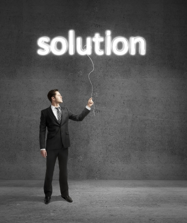 businessman standing on concrete room with solution Stock Photo - 18039755