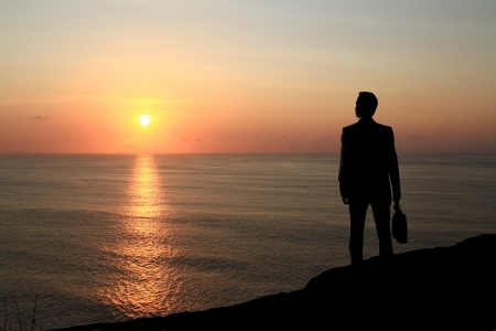 businessman standing on background of sunset Stock Photo - 18039717