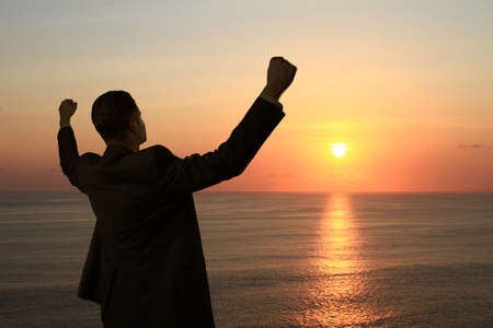 happy man standing  on background of sunset Stock Photo - 18039619