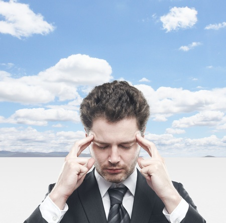 Businessman thinking on background of sky Stock Photo - 18039719