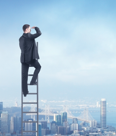corporate ladder: man climbing on ladder, urban business concept Stock Photo