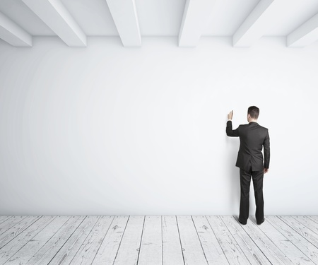 businessman drawing on white wall Stock Photo - 18068767