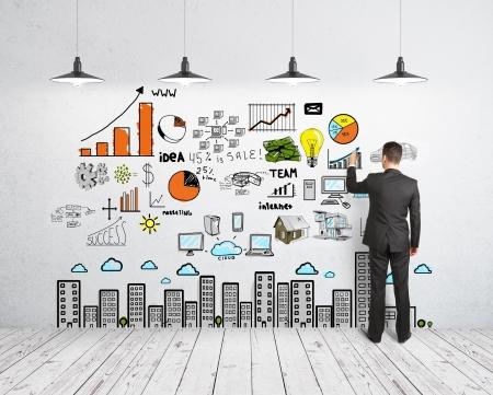 壁にビジネス コンセプトを図面の実業家 写真素材