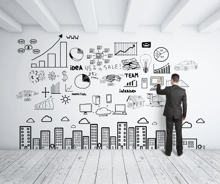 businessman drawing business concept on wall photo