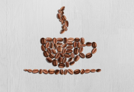 cup of coffee beans on a wood background Stock Photo - 18187668