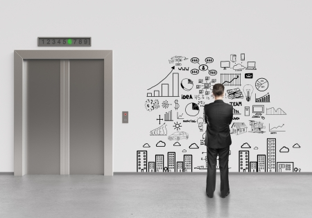 businessman looking at drawing business plan photo