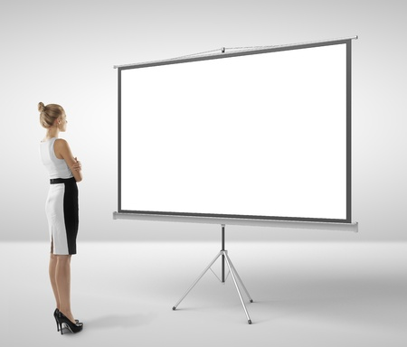 businesswoman looking at blank flipchart