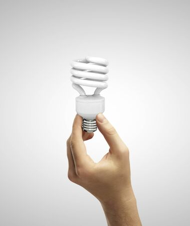 hand holding energy saving lamp  on a white background Stock Photo - 18187576