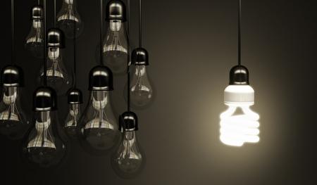 eficiencia energética: bombillas sobre fondo gris, concepto idea Foto de archivo