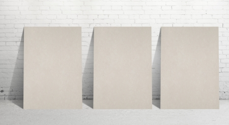 three paper stand and  brick wall photo