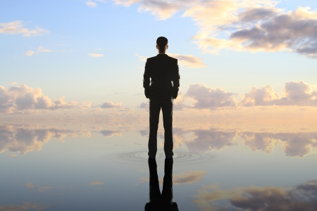 businessman standing on background of nature
