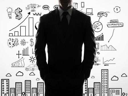 businessman with hands in pocket and drawing business concept photo